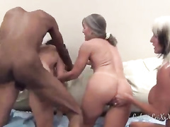 Three gorgeous women have fun with one chocolate fuckstick
